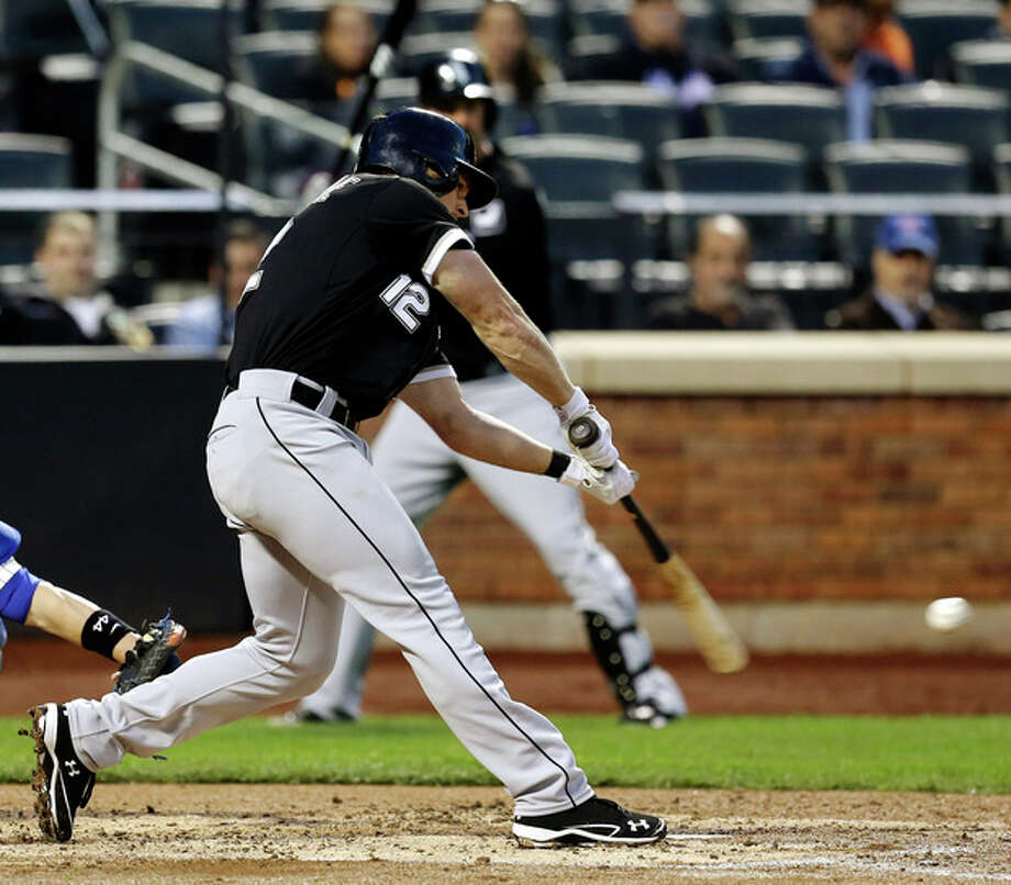 Chicago White Sox's Conor Gillaspie hits a two-RBI double during the third inning of a baseball game against the New York Mets at Citi Field, Wednesday, May 8, 2013 in New York. (AP Photo/Seth Wenig) / AP