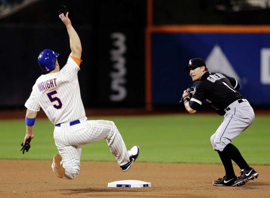 Chicago White Sox second baseman Tyler Greene, right, turns a double play as New York Mets' David Wright slides into second base during the fourth inning of a baseball game at Citi Field, Wednesday, May 8, 2013, in New York. (AP Photo/Seth Wenig) / AP