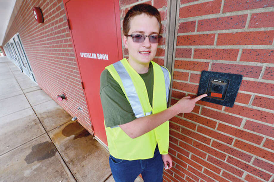 Hour photo / Erik TrautmannZach Rilling is going for his eagle scout badge with a project designed to highlight keyboxes for the fire department. / (C)2012, The Hour Newspapers, all rights reserved