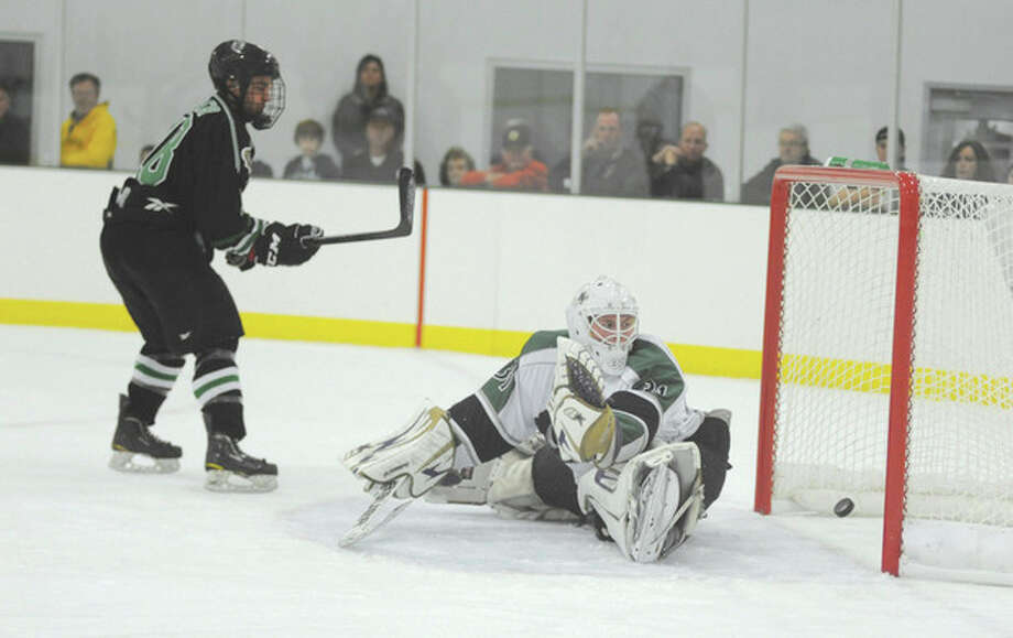 Hour photo/John NashConnecticut Oilers goaltender Nik Nugnes watches helplessly as the puck go into the net as South Shore's Brian Miller, left, scores on a breakaway in the first period of Saturday's EJHL contest at the SoNo Ice House. The Oilers suffered a 10-1.