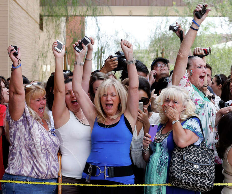 Spectators react to a guilty verdict in the murder trial of Jodi Arias, Wednesday, May 8, 2013 in Phoenix. Arias was convicted of first-degree murder Wednesday in the 2009 killing of her one-time boyfriend Travis Alexander after a four-month trial. (AP Photo/Matt York) / AP