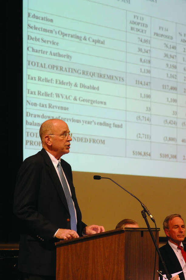Warren Serenbetz with the Wilton Board of Finance discusses the 2014 budget at the town hall meeting on Tuesday.