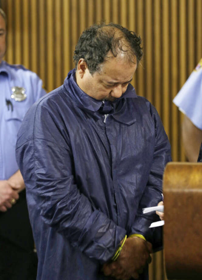 Ariel Castro appears in Cleveland Municipal court Thursday, May 9, 2013, in Cleveland. Castro was charged with four counts of kidnapping and three counts of rape. Ariel Castro was charged while his brothers, Pedro and Onil Castro, were held but faced no immediate charges. (AP Photo/Tony Dejak)
