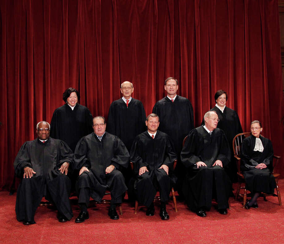 FILE - This Oct. 8, 2010 file photo shows the justices of the U.S. Supreme Court in a group portrait at the Supreme Court Building in Washington. The Supreme Court is embarking on a new term beginning Monday, Oct. 1, 2012, that could be as consequential as the last one with the prospect for major rulings about affirmative action, gay marriage and voting rights. Seated from left to right are: Associate Justice Clarence Thomas, Associate Justice Antonin Scalia, Chief Justice John G. Roberts, Associate Justice Anthony M. Kennedy, Associate Justice Ruth Bader Ginsburg. Standing, from left are: Associate Justice Sonia Sotomayor, Associate Justice Stephen Breyer, Associate Justice Samuel Alito Jr., and Associate Justice Elena Kagan. (AP Photo/Pablo Martinez Monsivais) / AP