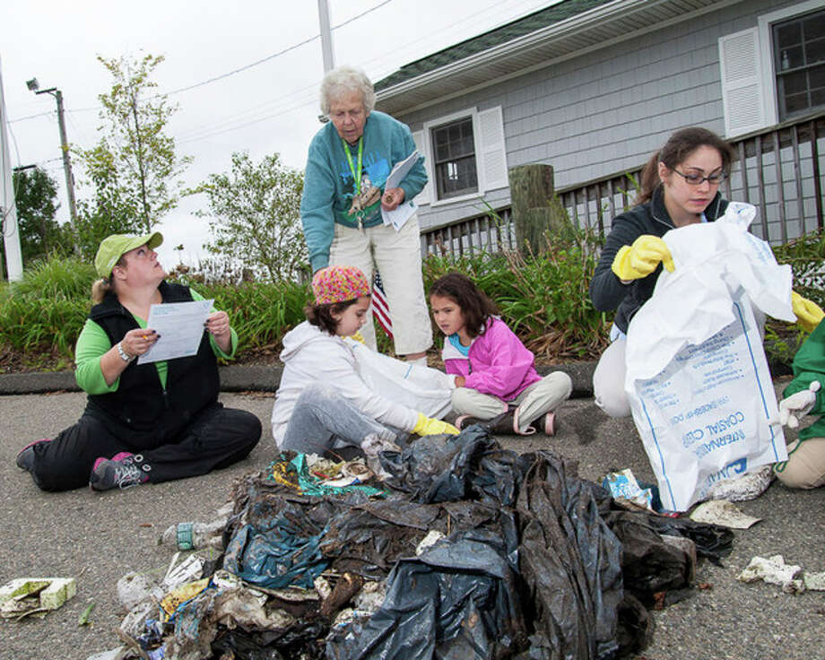 Photo by Miguel CruzGirl Scouts and Brownies from Norwalk this weekend were among the thousands of people worldwide to participate in the Ocean Conservancy's International Coastal Cleanup, a global volunteer effort that has taken place annually for more than 25 years.