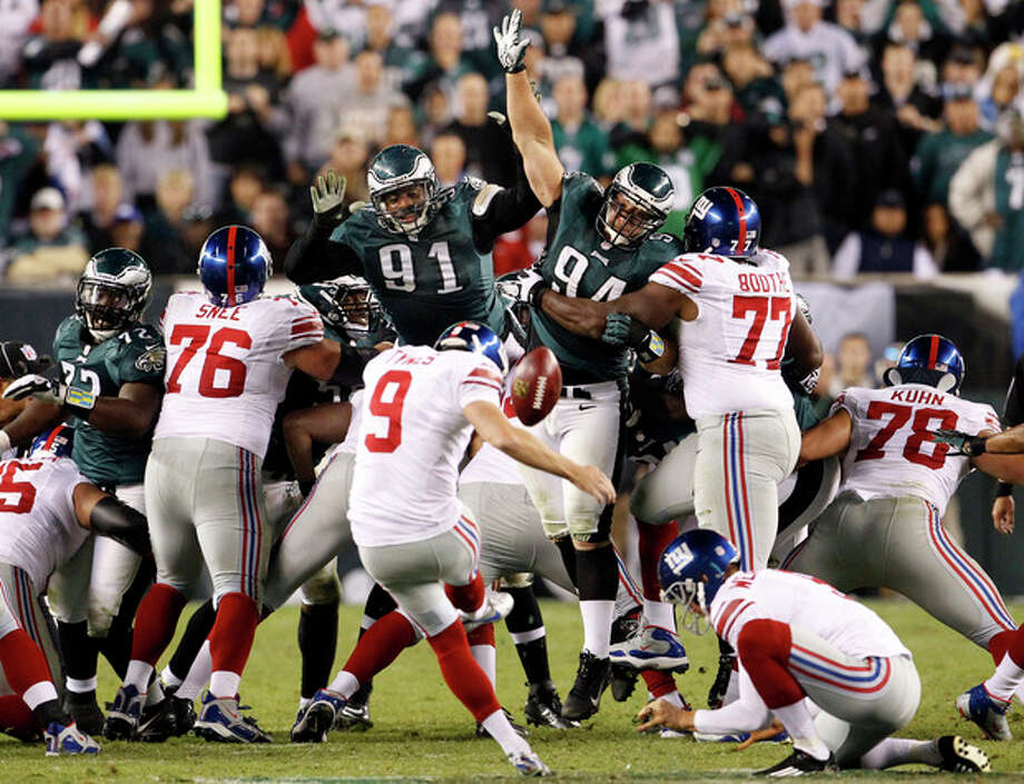 New York Giants kicker Lawrence Tynes (9) attempts a 54-yard field goal as a timeout is called during the second half of an NFL football game against the Philadelphia Eagles, Sunday, Sept. 30, 2012, in Philadelphia. The Eagles won 19-17. (AP Photo/The Philadelphia Inquirer, Ron Cortes) PHIX OUT; TV OUT; MAGS OUT; NEWARK OUT / Philadelphia Inquirer