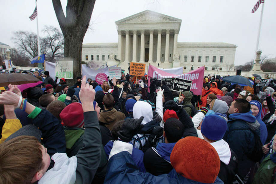 AP file photo / Manuel Balce CenetaIn this Jan. 23 file photo, anti-abortion and abortion rights supporters stand face to face in front of the Supreme Court in Washington during the annual March For Life rally. / AP