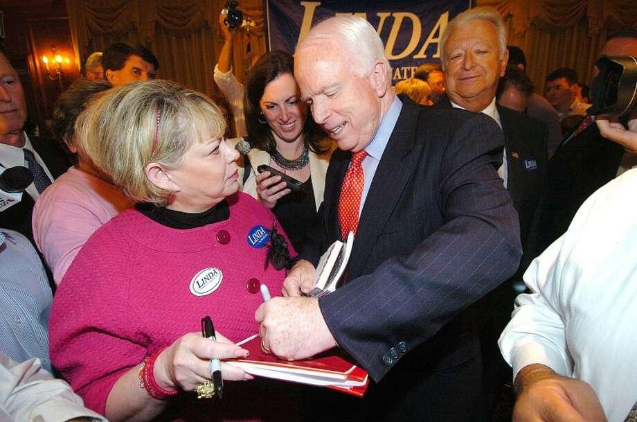 Hour Photo/ Alex von Kleydorff. Arizona Senator John McCain signs some autographs in Norwalk after speaking on behalf of Candidate Linda McMahon for Senate