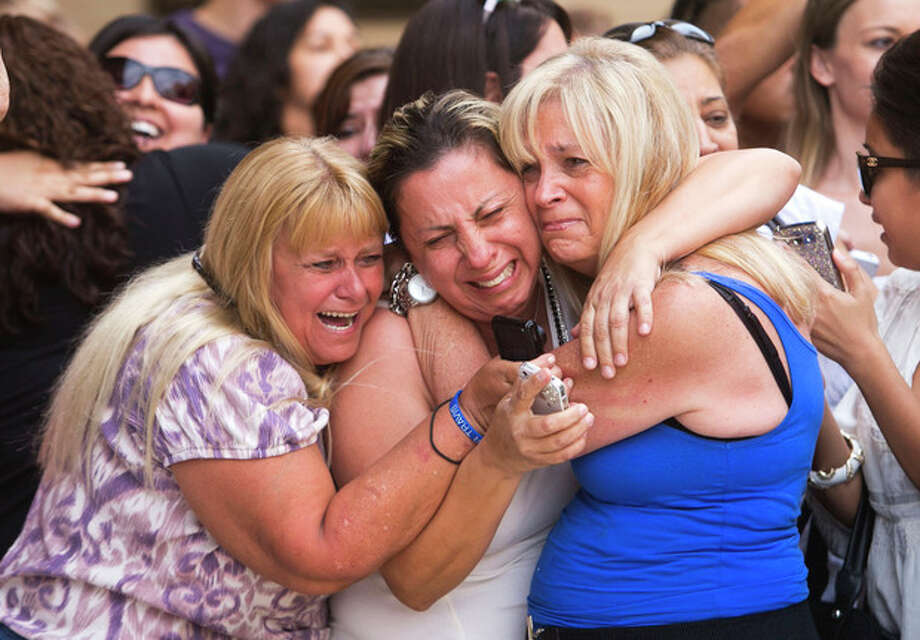 From left, Kathy Brown, of Paradise Valley, Virginia Aguiar, of Scottsdale, Jane Crook, of Scottsdale, react to a guilty verdict for Jodi Arias, Wednesday, May 8, 2013, outside of Maricopa County Superior Court in Phoenix. Arias was convicted of first-degree murder in the gruesome killing of her one-time boyfriend in Arizona after a four-month trial that captured headlines with lurid tales of sex, lies, religion and a salacious relationship that ended in a blood bath. (AP Photo/The Arizona Republic, David Wallace) MARICOPA COUNTY OUT; MAGS OUT; NO SALES / The Arizona Republic