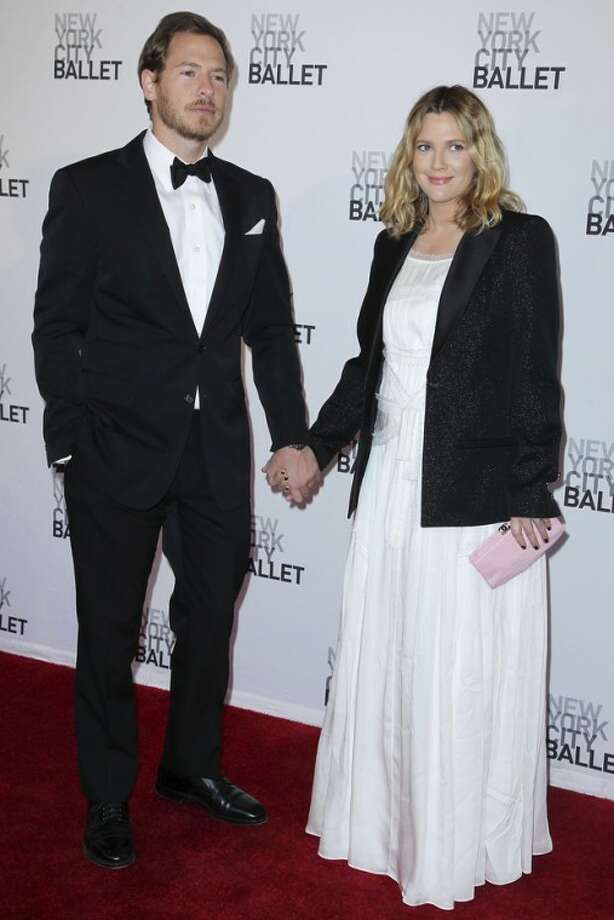 """FILE - This May 10, 2012 file photo shows Will Kopelman, left, and Drew Barrymore attending the New York City Ballet's 2012 Spring Gala performance in New York. The couple welcomed a baby girl named Olive Barrymore Kopelman on Sept. 26. A statement from Chris Miller at Barrymore's production company Flower Films said the baby was born """"happy, healthy and welcomed by the whole family."""" It did not provide specifics on the birth. (AP Photo/Starpix, Amanda Schwab, file)"""