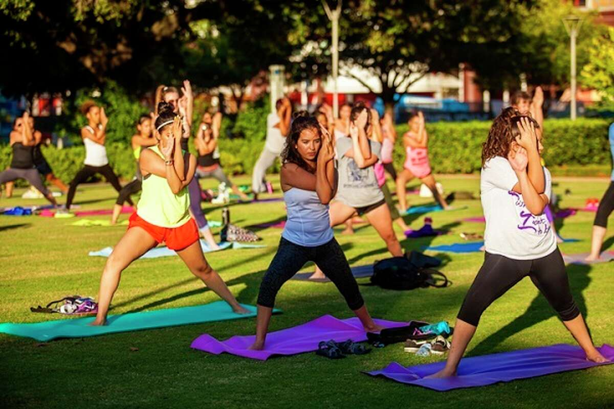 In previous years, yogis have gathered at Discovery Green in downtown Houston to celebrate the International Day of Yoga.