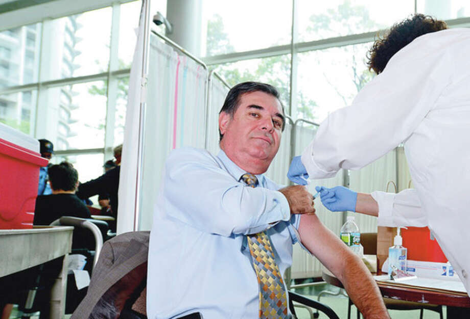 """Stamford mayor Michael Pavia receives a flu shot during the Stamford Hospital and The City of Stamford Department of Health and Social Services kick off press conference for their annual joint """"Fight the Flu"""" campaign on Tuesday at the Stamford Government Center.Hour photo / Erik Trautmann / (C)2012, The Hour Newspapers, all rights reserved"""