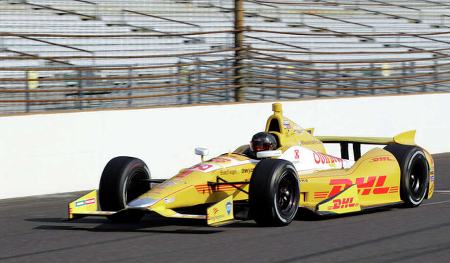 NASCAR driver Kurt Busch drives down the front straight away in an Andretti Autosport Indycar during a testing session at the Indianapolis Motor Speedway in Indianapolis, Thursday, May 9, 2013. (AP Photo/AJ Mast) / FR123854 AP