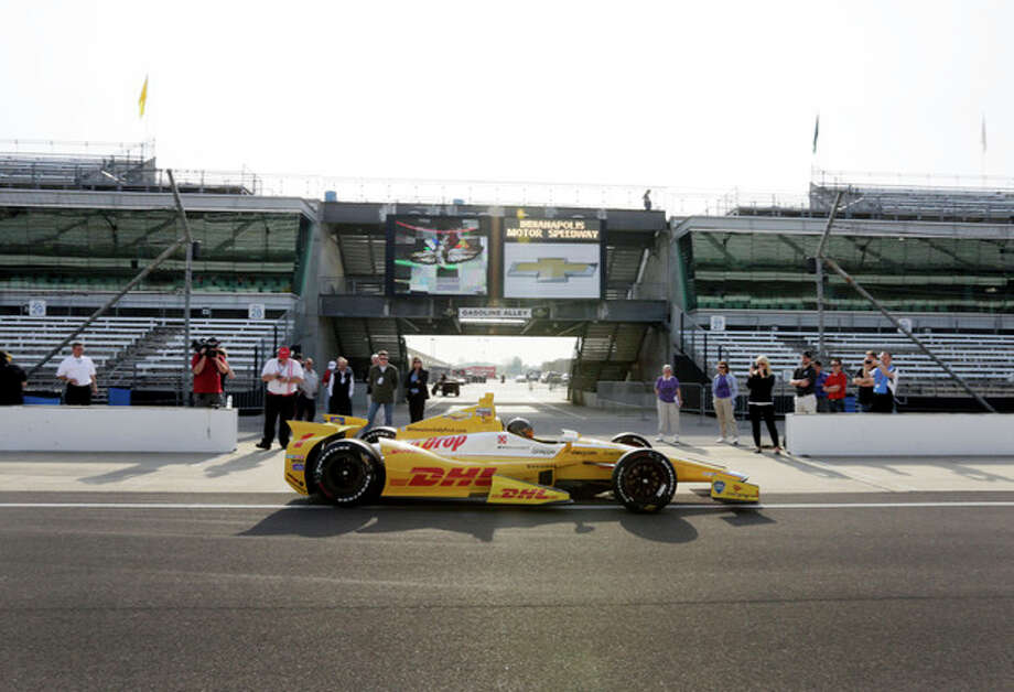 NASCAR driver Kurt Busch leaves the pit area in an Andretti Autosport Indycar during a testing session at the Indianapolis Motor Speedway in Indianapolis, Thursday, May 9, 2013. (AP Photo/AJ Mast) / FR123854 AP