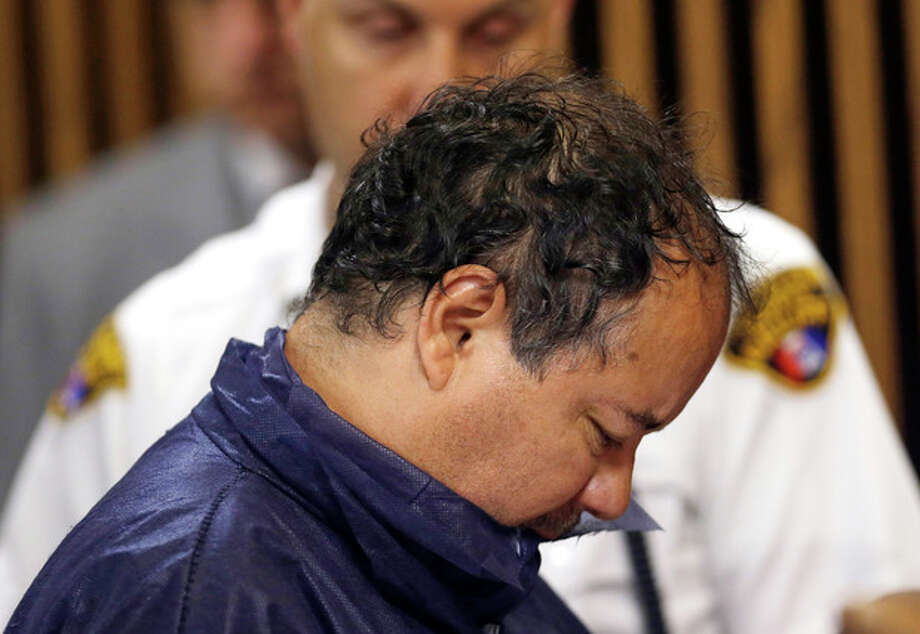 Ariel Castro appears in Cleveland Municipal court Thursday, May 9, 2013, in Cleveland. Castro was charged with four counts of kidnapping and three counts of rape. Ariel Castro was charged while his brothers, Pedro and Onil Castro, were held but faced no immediate charges. (AP Photo/Tony Dejak) / AP