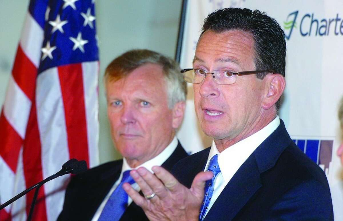 Hour Photo/ Alex von Kleydorff. Gov. Dan Malloy welcomes Charter Communications President and CEO Tom Rutledge to Stamford during a press conference at the companies new hspace at 400 Atlantic St in Stamford