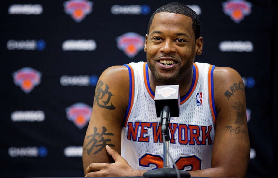 New York Knicks center Marcus Camby smiles as he answers a question during their NBA basketball media day at the team's training facility in Greenburgh, N.Y., Monday, Oct. 1, 2012. (AP Photo/Craig Ruttle) / FR61802 AP