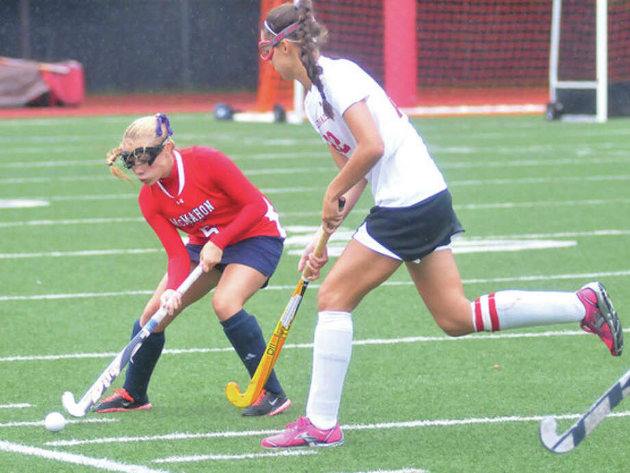 Hour photo/Matthew VinciBrien McMahon's Dominique D'Antonio, left tries to settle the ball as Elizabeth Stillman of Greenwich closes in during Tuesday's game in Greenwich. McMahon brought home a 1-0 victory.