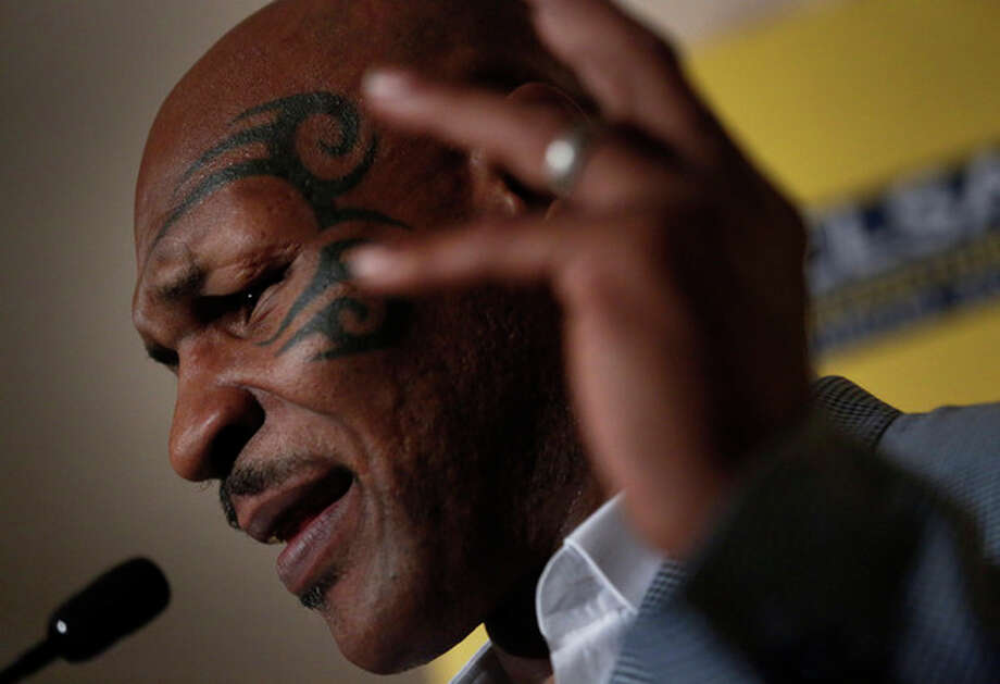 FILE - In this Sept. 12, 2012 file photo, former heavyweight boxing champion Mike Tyson speaks a press conference at the 19th Credit Lyonnais Securities Asia (CLSA) investors Forum at a hotel in Hong Kong. In a reversal, Mike Tyson has been denied entry to the country whose indigenous Maori people he says inspired his facial tattoo. New Zealand authorities on Wednesday, Oct. 3, 2012 canceled an entry visa for the former heavyweight boxing champion and convicted rapist, days after the prime minister spoke out against his planned visit. (AP Photo/Vincent Yu, File) / AP