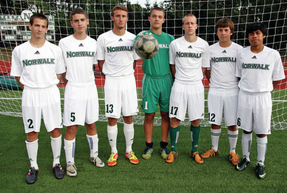 Norwalk High's soccer defense includes, from left, Mike Bonebrake, Carlos Teysseire, Andrew Melitsanopoulos, goalkeeper Svet Kozak, Paul Soja, Chris Miklave and Jose Canahui.Hour Photo / Danielle Robinson