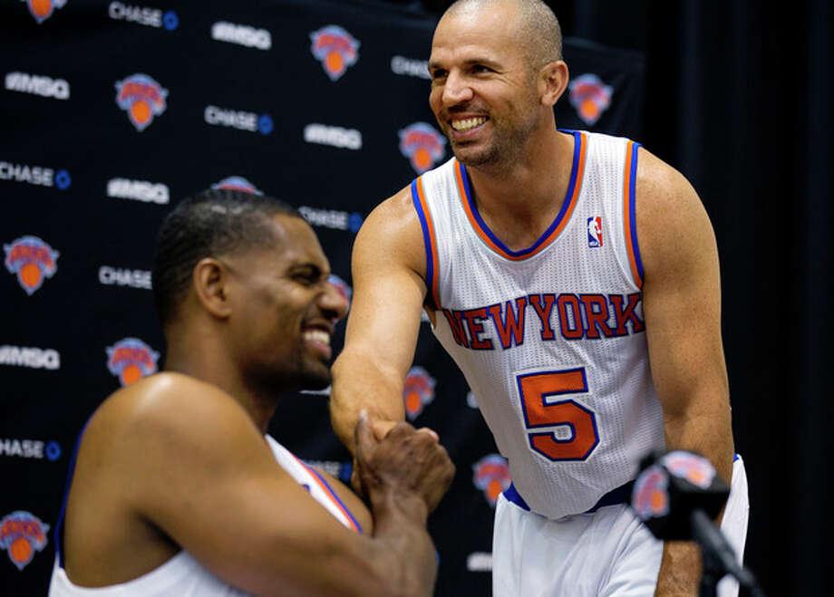 New York Knicks' Jason Kidd (5) shakes hands with Kurt Thomas during their NBA basketball media day at the team's training facility in Greenburgh, N.Y., Monday, Oct. 1, 2012. (AP Photo/Craig Ruttle) / FR61802 AP