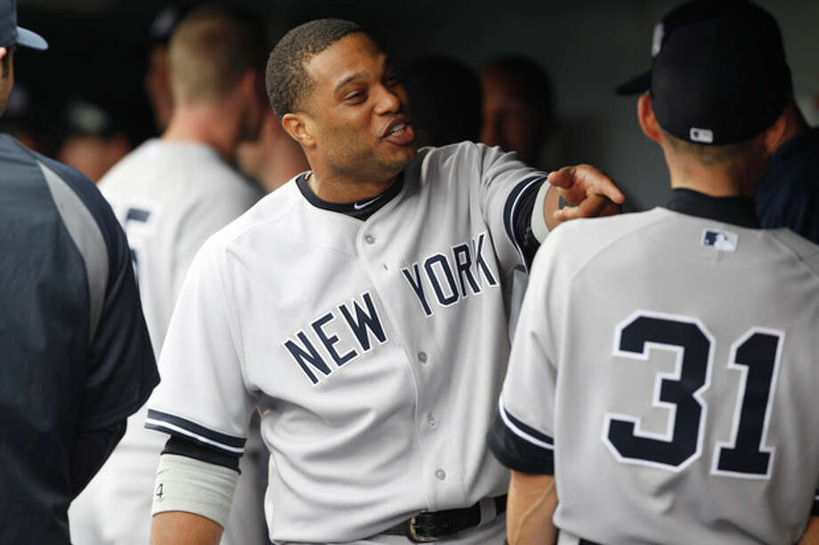 New York Yankees second baseman Robinson Cano, left, jokes with outfielder Ichiro Suzuki before a baseball game against the Colorado Rockies in Denver, Thursday, May 9, 2013. (AP Photo/David Zalubowski) / AP
