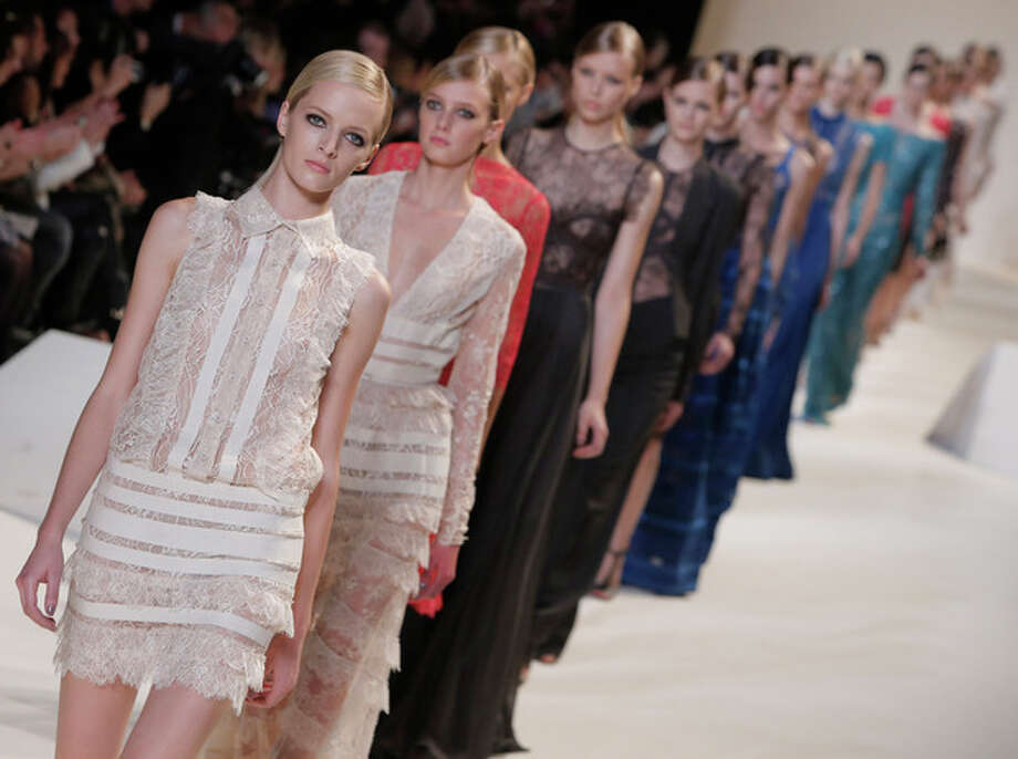 Models wear creations by designer Elie Saab as part of his ready to wear Spring-Summer 2013 collection, in Paris, Wednesday, Oct. 3, 2012. (AP Photo/Francois Mori) / AP