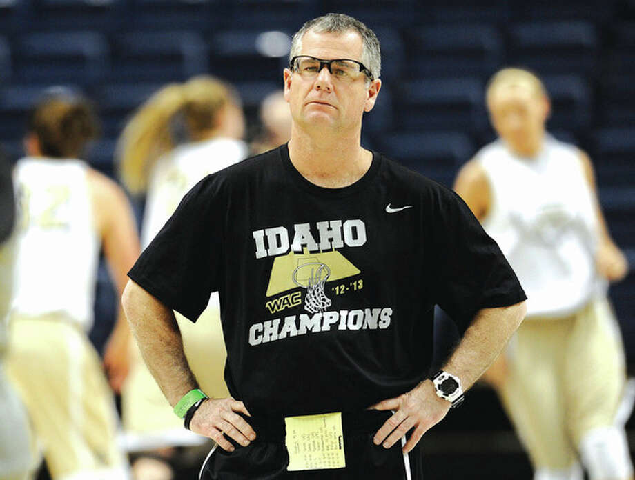 Idaho head coach Jon Newlee watches his team practice for a first-round game in the women's NCAA college basketball tournament in Storrs, Conn., Friday, March 22, 2013. Idaho will play Connecticut on Saturday. (AP Photo/Jessica Hill) / FR125654 AP