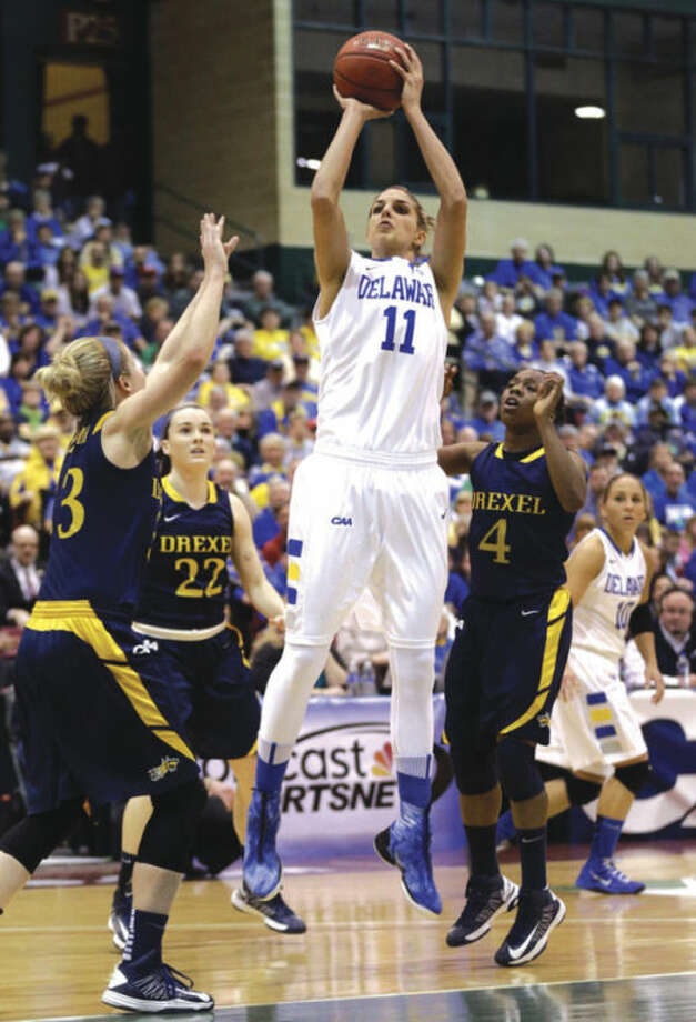 Delaware forward Elena Delle Donne (11) shoots over Drexel guards, from left, Fiona Flanagan, Meghan Creighton and Renee Johnson-Allen during the first half of an NCAA college basketball game in the championship of the Colonial Athletic Association conference tournament in Upper Marlboro, Md., Sunday, March 17, 2013. (AP Photo/Patrick Semansky)