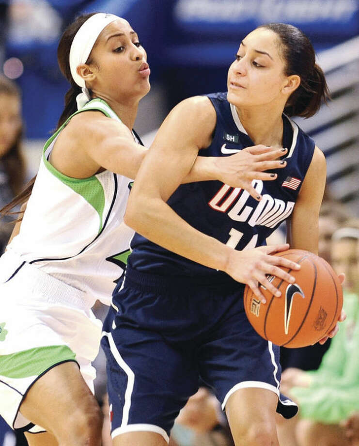 Connecticut's Bria Hartley, right, is guarded by Notre Dame's Skylar Diggins in the first half of an NCAA college basketball game in the final of the Big East Conference women's tournament in Hartford, Conn., Tuesday, March 12, 2013. (AP Photo/Jessica Hill)