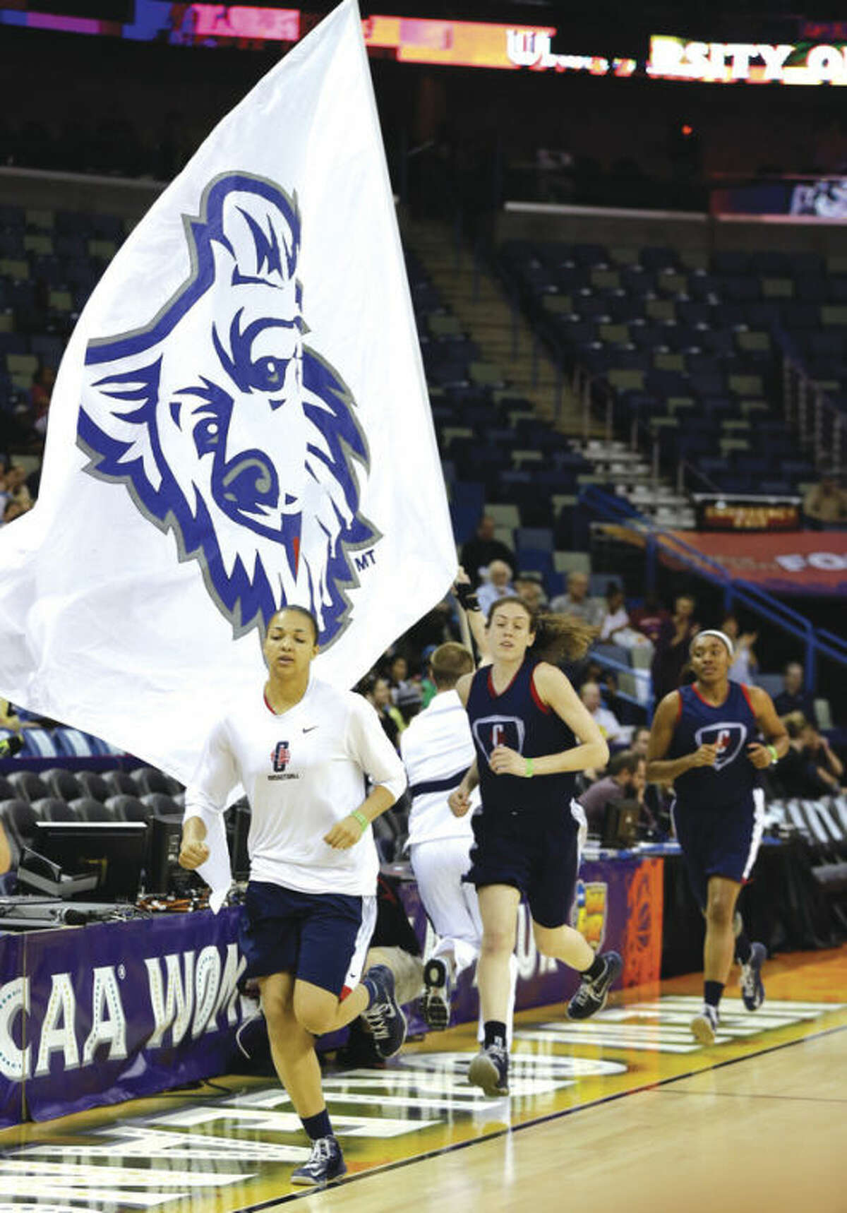 AP photo Connecticut's Kiah Stokes, Breanna Stewart and Moriah Jefferson jog on to the court for practice Saturday at the Women's Final Four in New Orleans. UConn plays Notre Dame in a national semifinal on Sunday after Louisville takes on California. The championship game is Tuesday night.