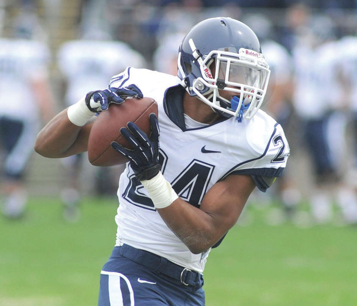Hour photo/John Nash Noel Thomas of Norwalk, a graduate of St. Luke's School, got his first official game action with the University of Connecticut football team on Saturday, suiting up as a wide receiver during the Huskies annual Spring Blue-White game.