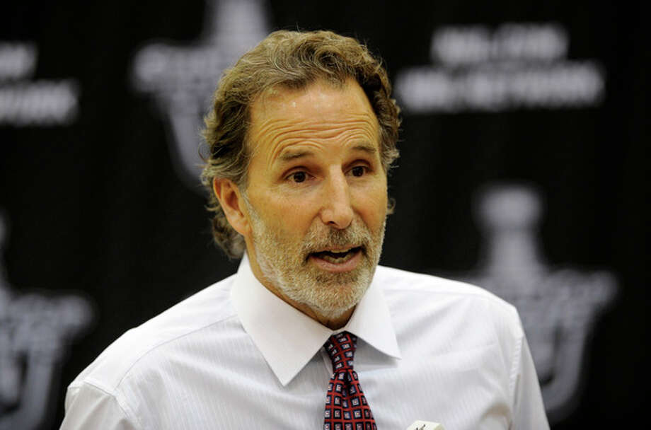 New York Rangers head coach John Tortorella talks to the media during a press conference following the Game 7 first-round NHL Stanley Cup playoff hockey series against the Washington Capitals, Monday, May 13, 2013, in Washington. The Rangers won 5-0. (AP Photo/Nick Wass) / FR67404 AP