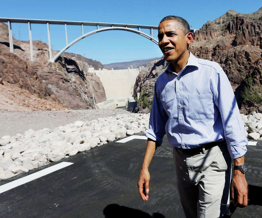 President Barack Obama stands at the heliport overlooking the Hoover Dam, Tuesday, Oct. 2, 2012 in Boulder City, Nev. (AP Photo/Pablo Martinez Monsivais) / AP