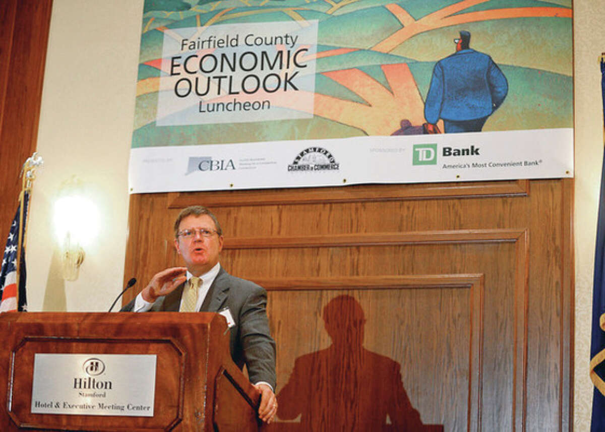 Hour photos / Erik Trautmann At left, the Stamford Chamber of Commerce hosts their Fairfield County Economic Outlook luncheon at the Stamford Hilton with keynote speaker Dick Peach of the Federal Reserve Bank of NY Wednesday. At right, keynote speaker Chief FX Strategist, TD Securities, Shaun Osbourne speaks atteh gathering.