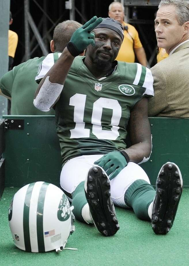 FILE - This Sept. 30, 2012 file photo shows New York Jets wide receiver Santonio Holmes (10) gesturing to fans as he is carted off the field after being injured during the second half of an NFL football game against the San Francisco 49ers, in East Rutherford, N.J. Holmes will miss the rest of this season with a Lisfranc injury in his left foot, leaving the struggling New York Jets without their top offensive playmaker. The Jets announced Wednesday, Oct. 3, 2012, that Holmes, who will require surgery, was placed on season-ending injured reserve. (AP Photo/Bill Kostroun, File)