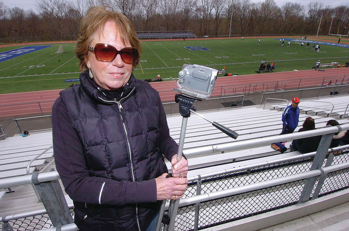 Hour Photo/Alex von Kleydorff Barb McNulty and her trusty video camera were at Thursday's Staples lacrosse game. The wife of Wreckers' head coach Paul McNulty has been taping games for her husband's teams for two decades.