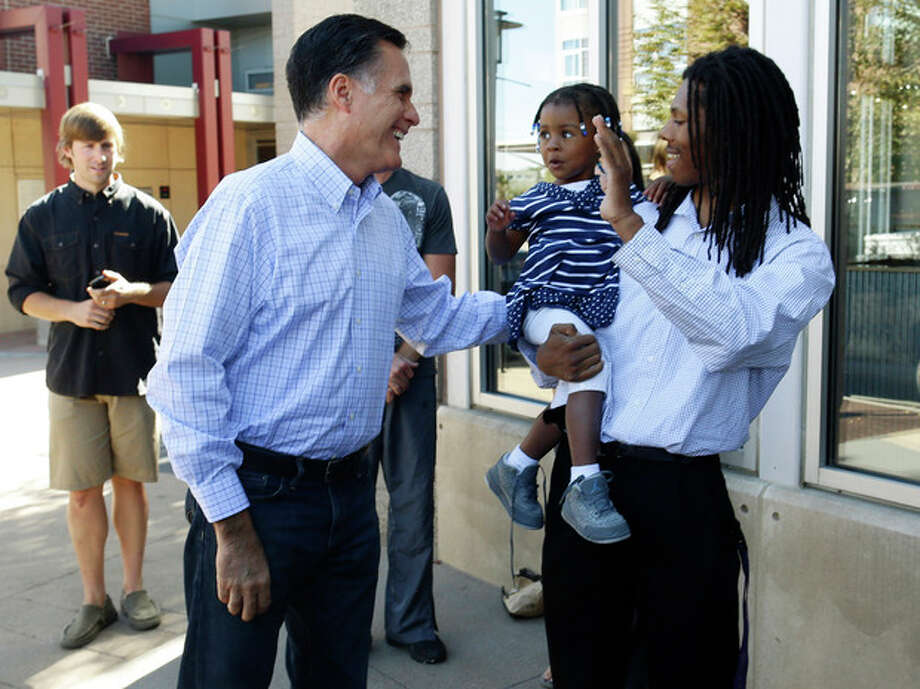Republican presidential candidate, former Massachusetts Gov. Mitt Romney greets passers-by as he makes an unscheduled stop at a Chipotle restaurant in Denver, Tuesday, Oct. 2, 2012. (AP Photo/Charles Dharapak) / AP