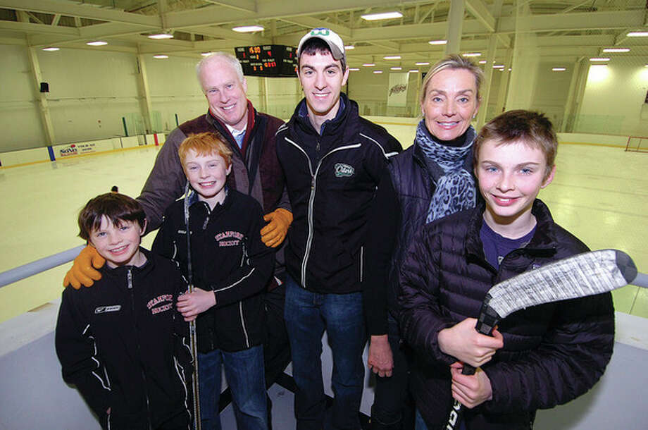 Hour Photo/ Alex von KleydorffConnecticut Oilers' player Conor Lamberti, center, is surrounded by his host family, the Gibsons of Rowayton, from left, Nat, Cooper, father Tim, mother Tracy and Remy. / 2013 The Hour Newspapers