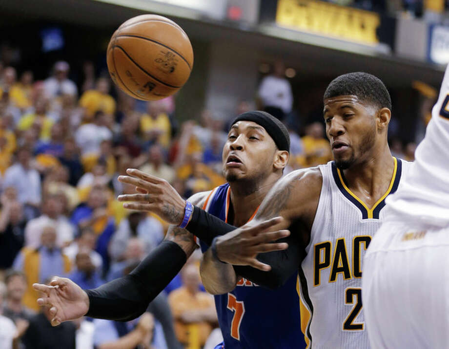 New York Knicks' Carmelo Anthony, left, and Indiana Pacers' Paul George vie for a rebound during the first half of Game 4 of an Eastern Conference semifinal NBA basketball playoff series, on Tuesday, May 14, 2013, in Indianapolis. (AP Photo/Darron Cummings) / AP