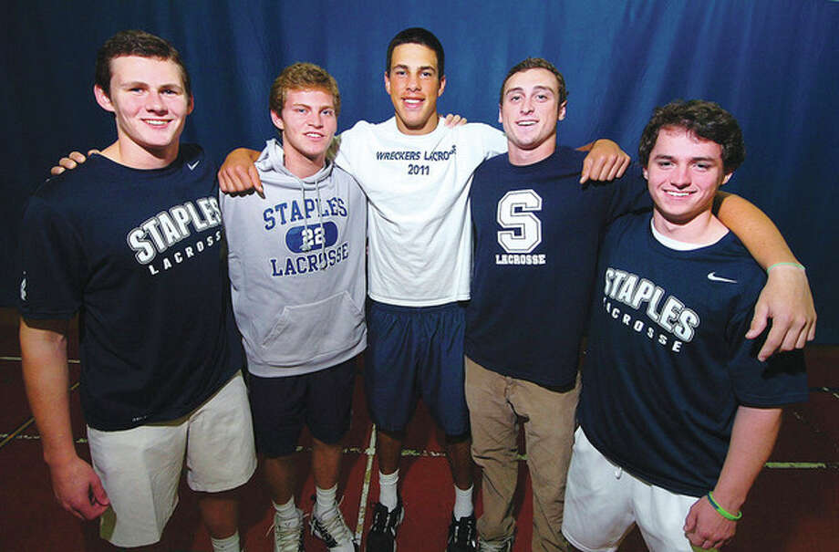 Hour Photo Alex von KleydorffStaples lacrosse players, from left, Colin Bannon, Joey Zelkowitz, Lance Lonergan Jr., Quinn Mendelson and James Hines all have plans to play lacrosse in college. / 2012 The Hour Newspapers