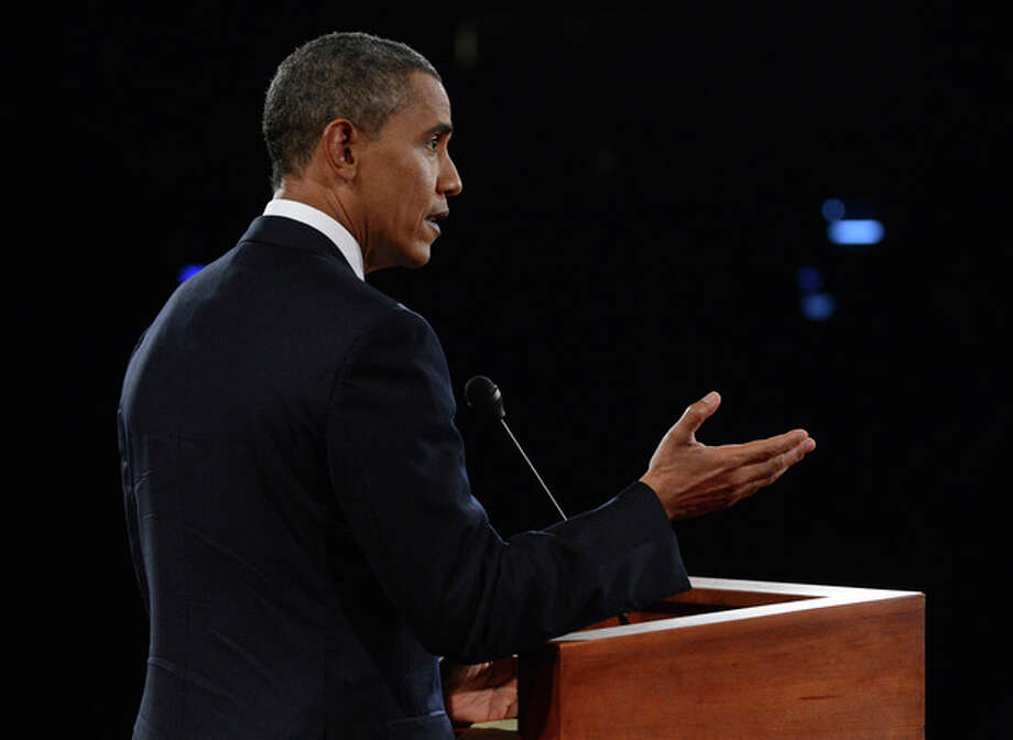 President Barack Obama answers a question during the first presidential debate at the University of Denver, Wednesday, Oct. 3, 2012, in Denver. (AP Photo/Pool-Michael Reynolds) / EPA Pool