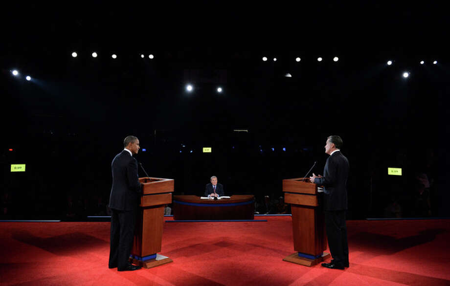 President Barack Obama and Republican presidential nominee Mitt Romney participate in the first presidential debate at the University of Denver, Wednesday, Oct. 3, 2012, in Denver. (AP Photo/Pool-Michael Reynolds) / EPA Pool