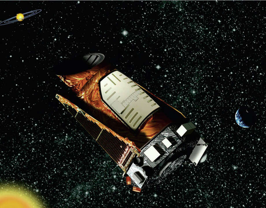This artist rendition provided by NASA shows the Kepler space telescope. The spacecraft lost the second of four wheels that control the telescope's orientation in space, NASA said Wednesday, May 15, 2013. If engineers can't find a fix, the failure means the telescope won't be able to look for planets outside our solar system anymore. (AP Photo/NASA) / NASA/JPL