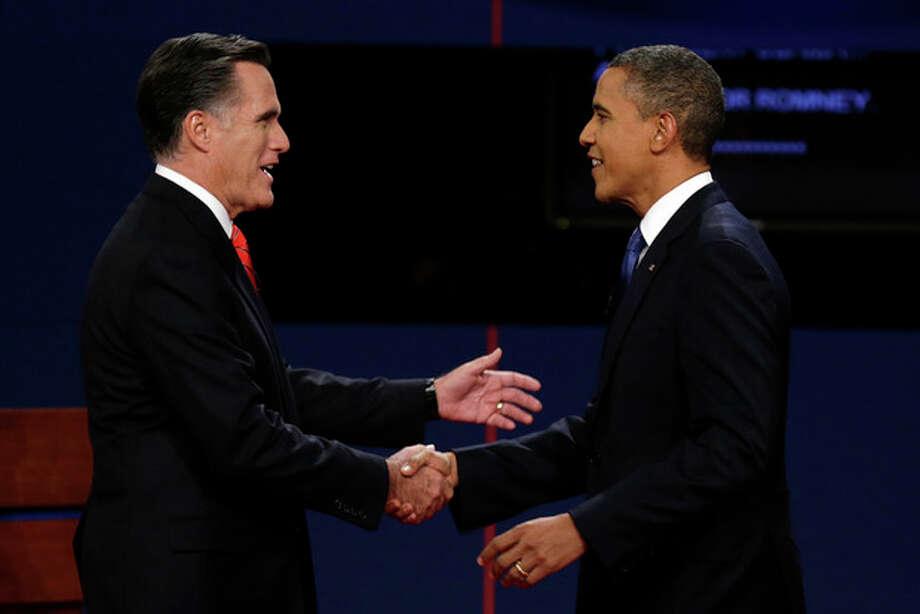 Republican presidential nominee Mitt Romney and President Barack Obama shake hands before the first presidential debate at the University of Denver, Wednesday, Oct. 3, 2012, in Denver. (AP Photo/Charlie Neibergall) / AP