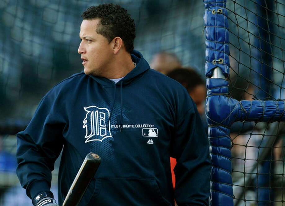 Detroit Tigers' Miguel Cabrera finishes his turn during batting practice before a baseball game with the Kansas City Royals at Kauffman Stadium in Kansas City, Mo., Wednesday, Oct. 3, 2012. (AP Photo/Orlin Wagner) / AP