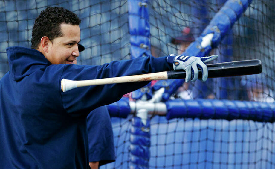 Detroit Tigers' Miguel Cabrera points to fans during batting practice before a baseball game with the Kansas City Royals at Kauffman Stadium in Kansas City, Mo., Wednesday, Oct. 3, 2012. (AP Photo/Orlin Wagner) / AP