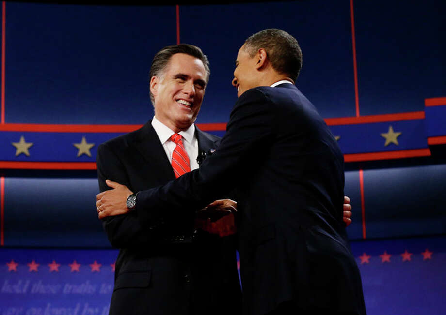 President Barack Obama and Republican presidential candidate and former Massachusetts Gov. Mitt Romney meet on stage at the start of the first presidential debate in Denver, Wednesday, Oct. 3, 2012. (AP Photo/Charles Dharapak) / AP