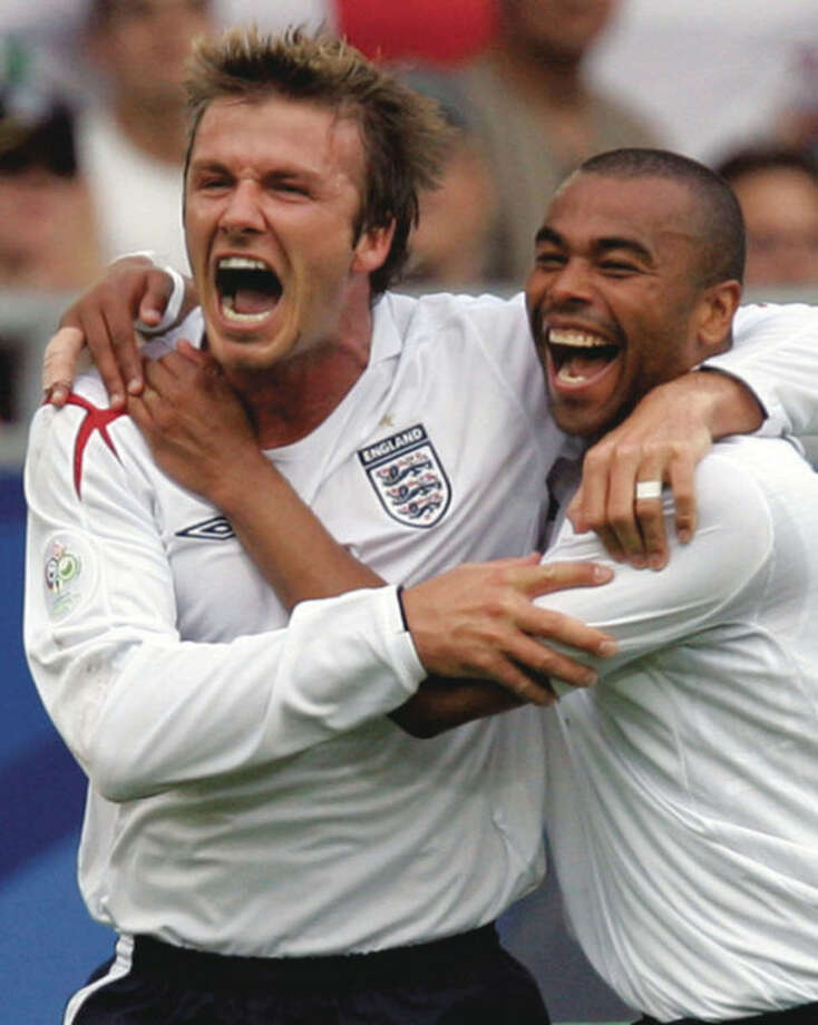 FILE - In this June 25, 2006 file photo, England's captain David Beckham, left, celebrates his opening goal against Ecuador in a World Cup soccer match at the Gottlieb-Daimler stadium in Stuttgart, Germany. Beckham says he is retiring from soccer at the end of the season. The 38-year-old Beckham recently won a league title in a fourth country with Paris Saint-Germain. He has become a global superstar since starting his career at Manchester United. (AP Photo/Thomas Kienzle, File)