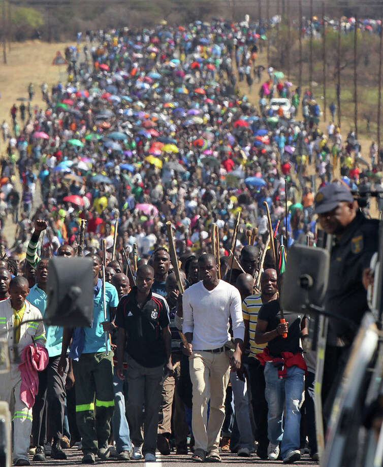 FILE In this photo taken Monday Sept. 10, 2012 miners march to Lonmin Platinum Mine near Rustenburg, South Africa in an attempt to stop operations. The current unrest in the mining industry started in August with the miners staging a wildcat strike that led to a violent confrontation in which police shot and killed 34. More than 70 others were wounded in the worst case of of state-led violence since the end of apartheid. (AP Photo/Themba Hadebe-file) / AP